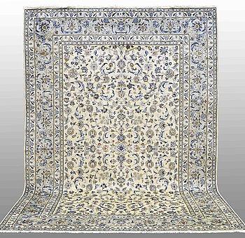 A carpet Kashan, ca 365 x 245 cm.