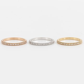 Three rings set with brilliant cut diamonds.
