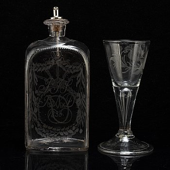 A WINE GLASS AND BOTTLE, 18th and 19th century.