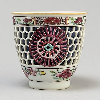 """A famille rose and powder blue """"devils work"""" cup, Qing dynasty, Qianlong (1736-95)."""