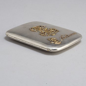 A silver cigarette case decorated with letters in gold, unknown maker, Moscow 1908-1917.