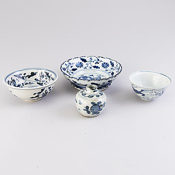 Four pieces of Chinese porcelain, two of which dated to the Ming dynasty (1364-1644).