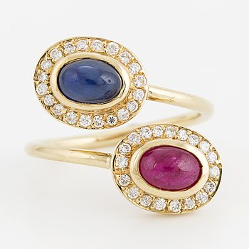 A sapphire and ruby and diamond cross over ring.