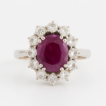A ruby and brilliant-cut diamond ring.