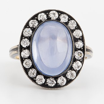 A ring set with a cabochon-cut sapphire ca 9.0 ct and old-cut diamonds.