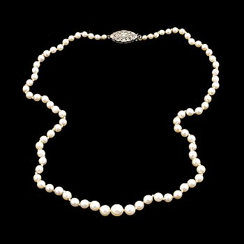 A calibrated cultured pearl necklace, clasp with diamonds.