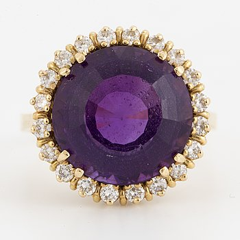 A mixed-cut amethyst and brilliant-cut diamond cocktail ring.