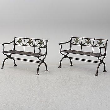 GARDEN SOFAS, a pair, cast iron, empire style, late 19th century.