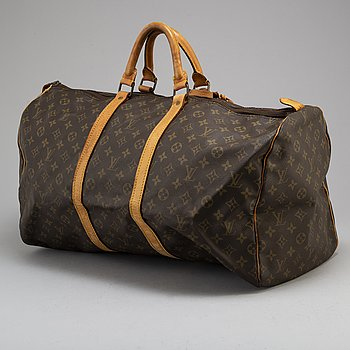 LOUIS VUITTON, a 'Keepall 55' monogram canvas weekend bag.