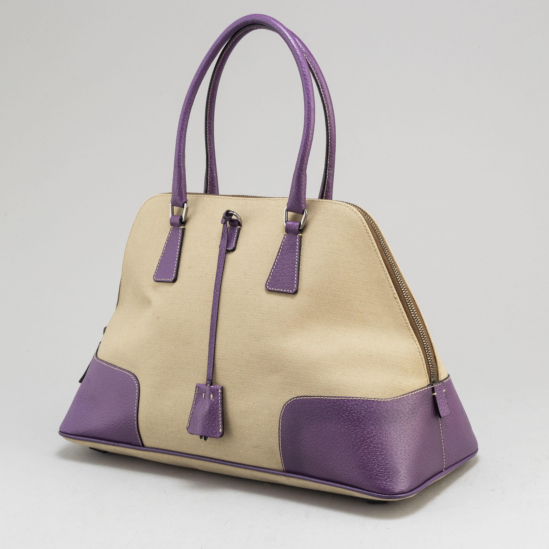 4ec8fc74 PRADA, a canvas and leather bag. - Bukowskis