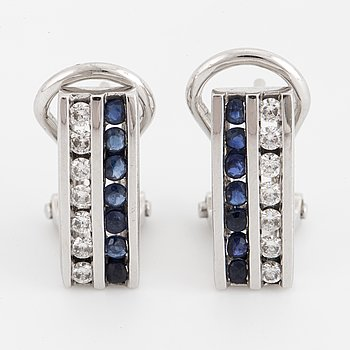 A pair of 14K white gold, sapphire and diamond earrings.