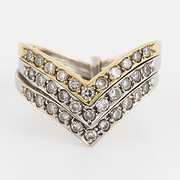 An 18K gold and eight-cut diamond ring.