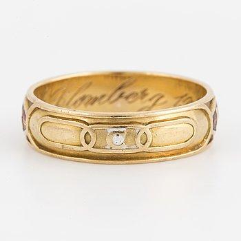 An Odd Fellow 18K gold ring.