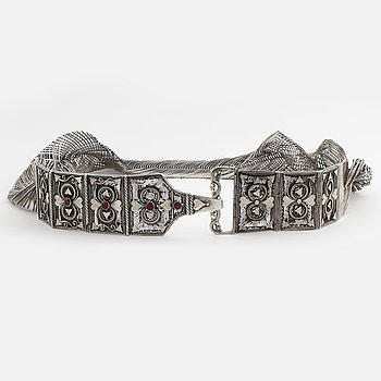 A silver and synthetic ruby belt.