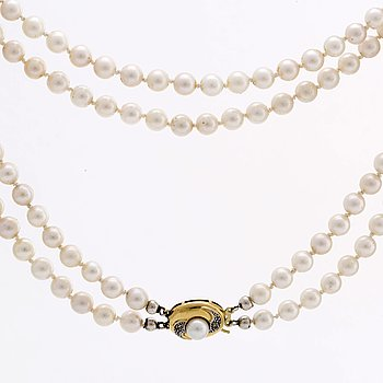 PEARL NECKLACE 2 rows of cultured pearls approx 6 mm clasp 18K gold w 1 cultured pearl and 2 single-cut diamonds.