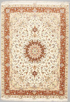 A CARPET, Tabriz, part silk, around 350 x 244 cm.