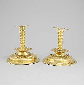 A pair of 19th century Baroque style brass candel sticks.