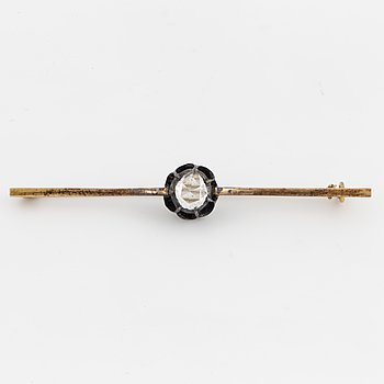An 18K gold and silver and rose-cut diamond brooch.