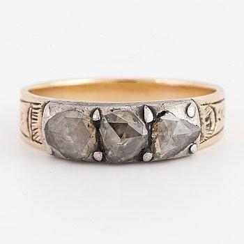 A rose-cut diamond ring.