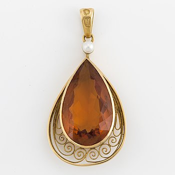 A pear shaped citrine pendant and seed pearl.