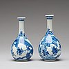 A pair of blue and white pear shaped vases, qing dynasty, kangxi (1662-1722).