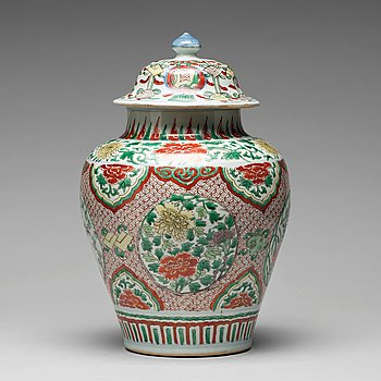 572. A Transitional wucai baluster vase with cover, 17th Century.