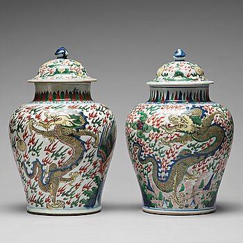 569. Two Transitional Wucai Baluster vases and covers, 17th Century.