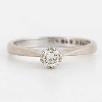 A solitaire briliant-cut diamond ring.