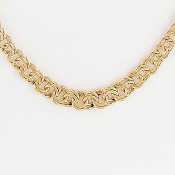 18K gold necklace.