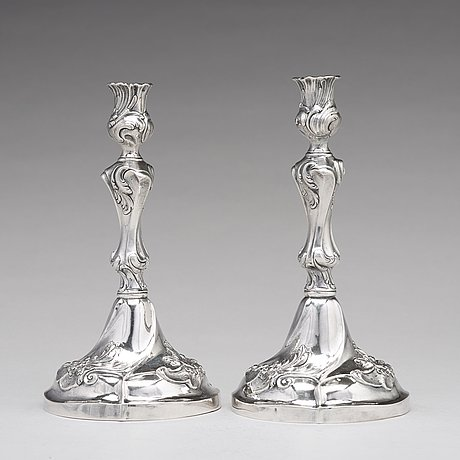 A pair of swedish 18th century rococo silver candlesticks, mark of jacob lampa, stockholm 1772.