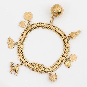 A 18K gold bracelet.