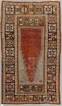 A RUG, Antique Anatol, around 182 x 104,5 - 107 cm.