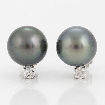 A pair of cultured Tahiti pearl earrings with brilliant-cut diamonds.