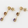 A pair of 18k gold and cabochoncut citrine and amethyst earrings, box w.a bolin.