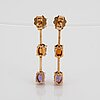 A pair of 18k gold earrings set with cabochon-cut citrines and amethysts.