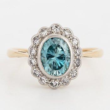 Blue zircon and diamond cluster ring.