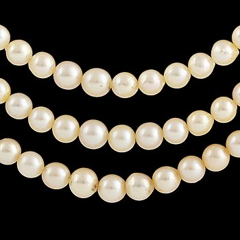 Three strand cultured pearl necklace, clasp with old-cut diamonds.