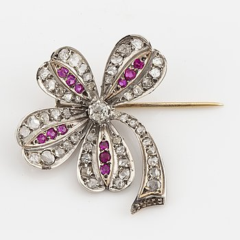 Ruby and diamond clover brooch.