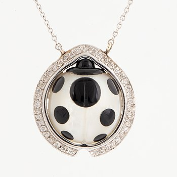 A ladybug necklace with mother of pearl, onyx and brilliant-cut diamonds.
