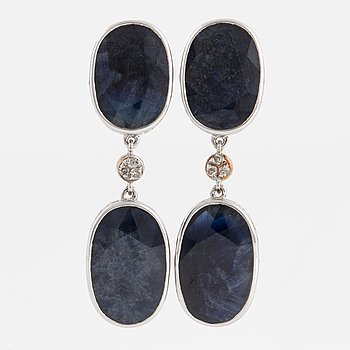 Oval faceted sapphire and eight-cut diamond earrings.
