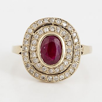 Ruby and diamond gold cluster ring.