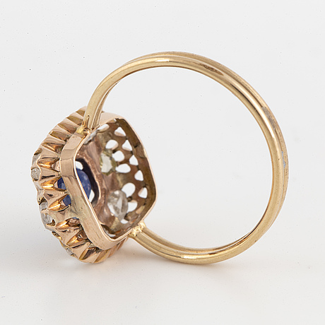 Oval faceted sapphire and rose cut diamond cluster ring