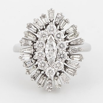A marquise, brilliant, and tapered baguette-cut diamond ring,