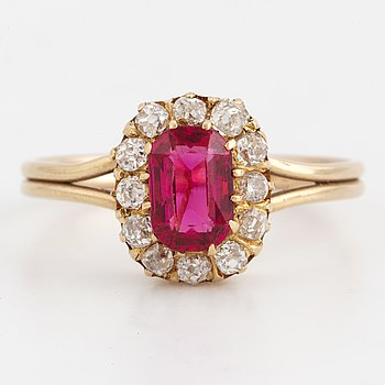 A pinkish red spinel and old-cut diamond cluster ring.