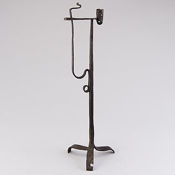 A 18th century wrought iron rush light and candle holder.