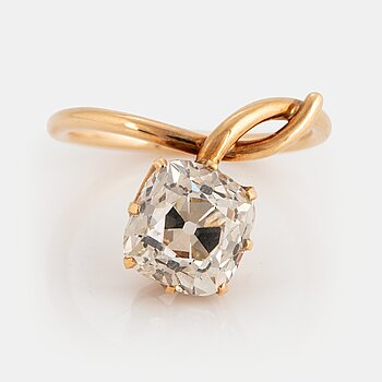 915. A 14K gold ring set with an old-cut diamond ca 3.50 cts quality ca J/K vs.