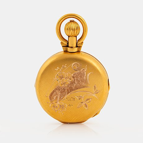A 14k engraved gold locket.