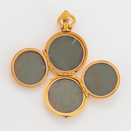Medaljong 14k guld med gravyr.