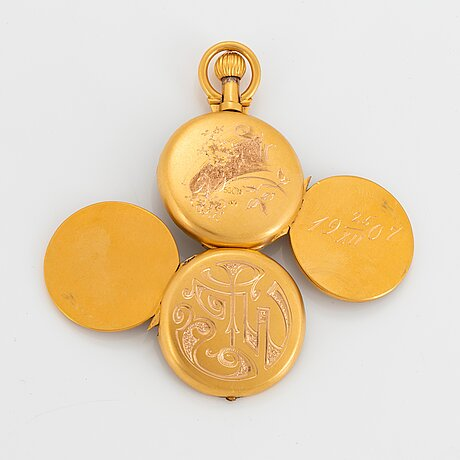 A 14k engraved gold locket.