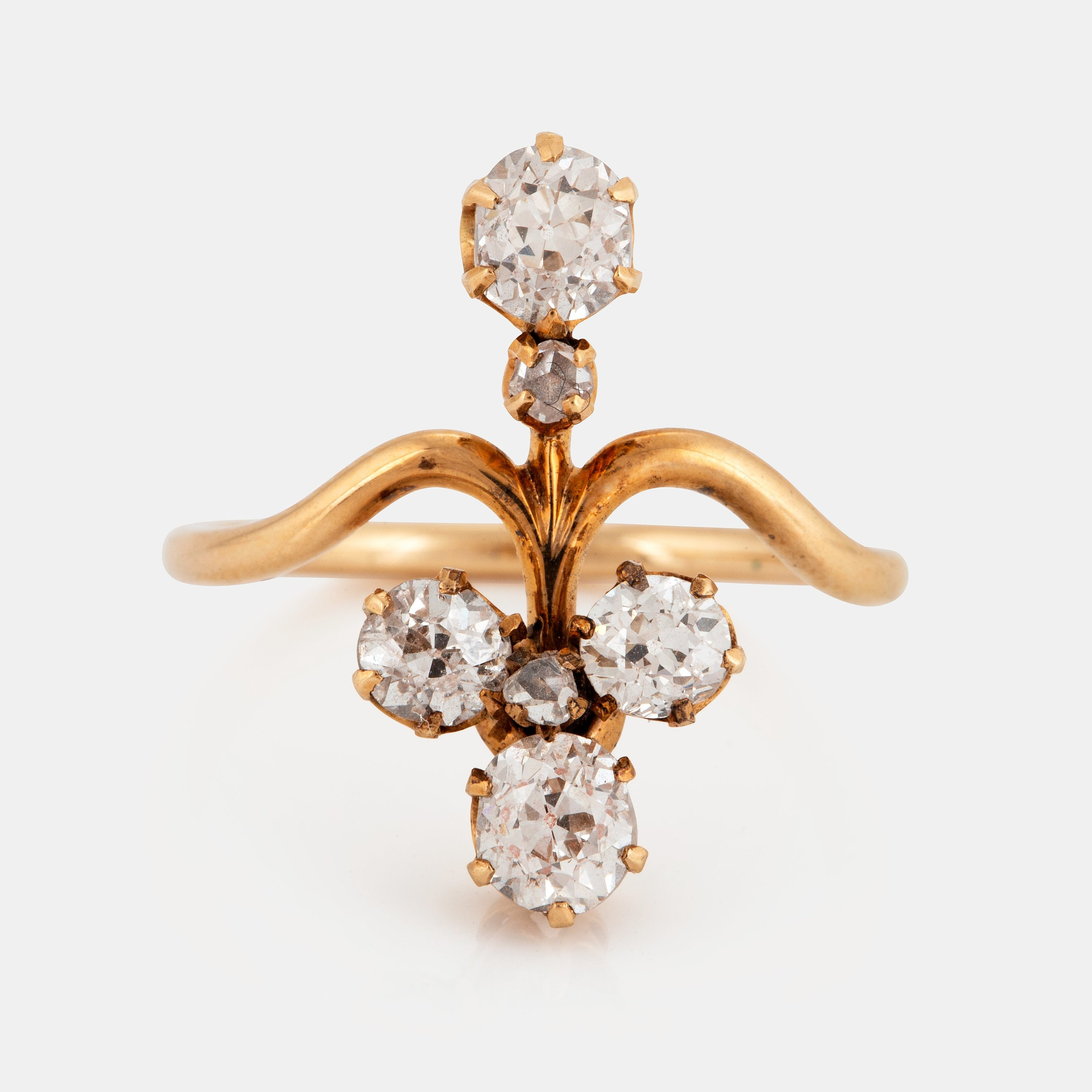 A 14K gold ring set with old- and rose-cut diamonds with a total